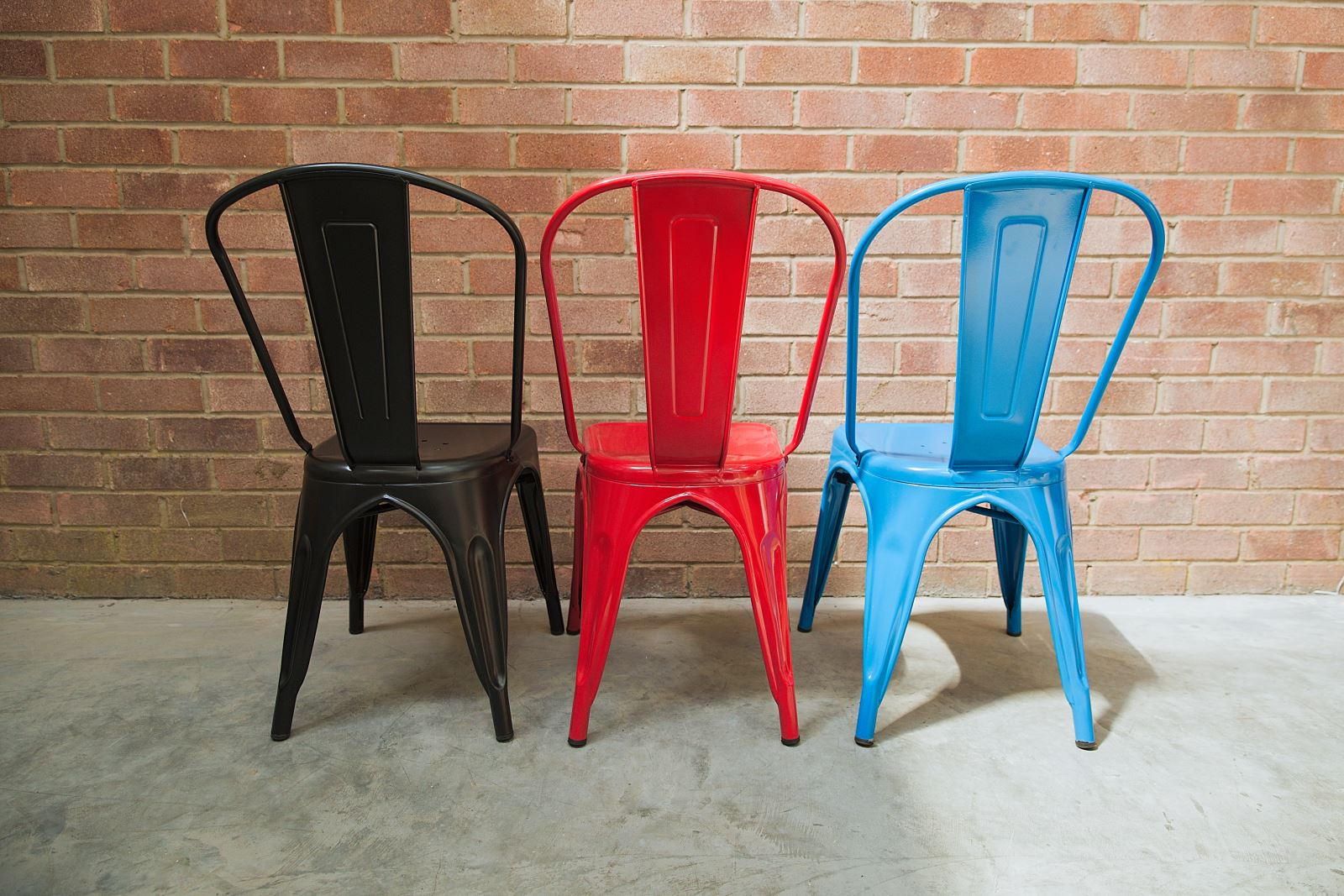 Coloured metal stack chairs - Trent Furniture
