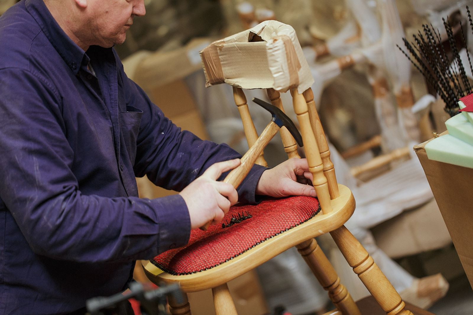 Expert upholsterers finishing chairs