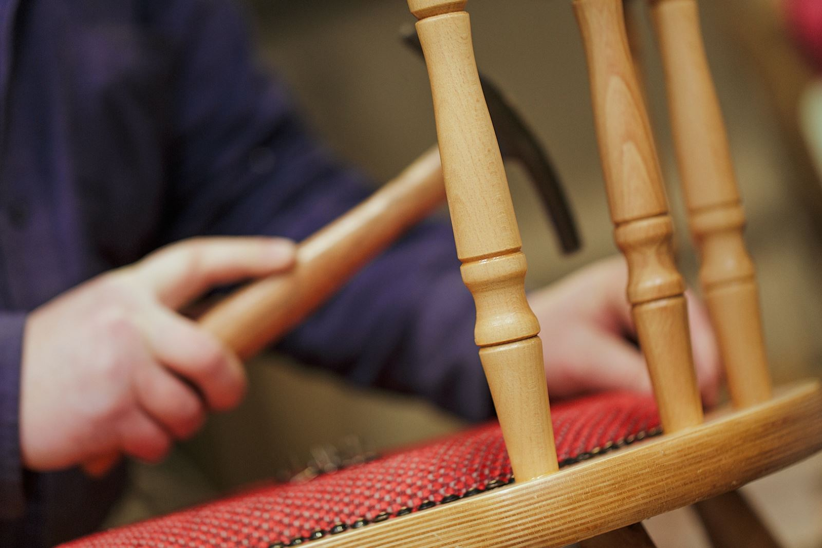 Expert building and finishing a wooden chair