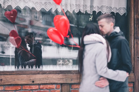 Couple outside a restaurant on Valentine's Day