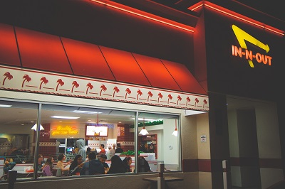 Fast food restaurant exterior showing customers sat inside