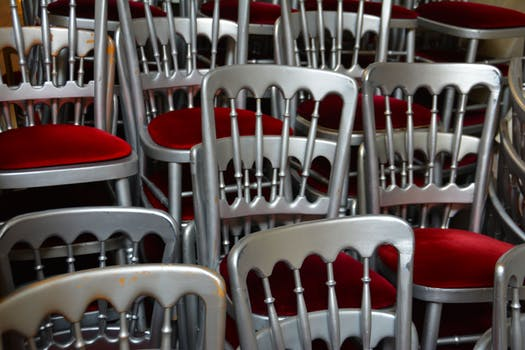 black and white vintage stacking chairs in cafe setting