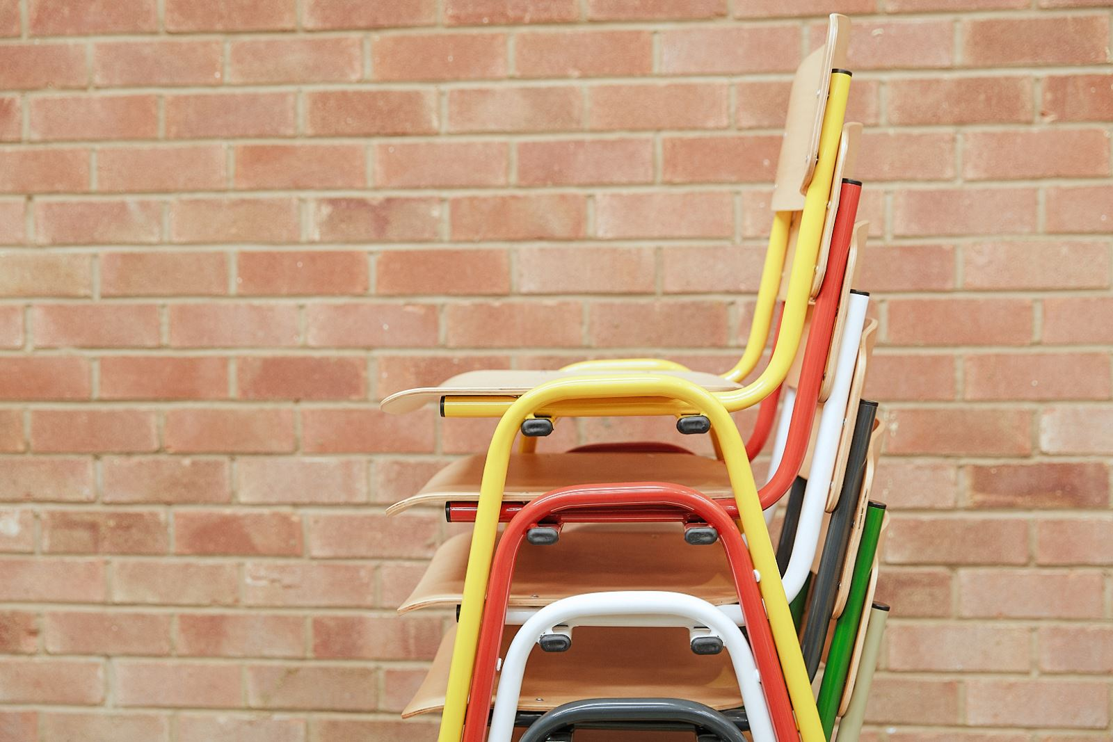 Stacking chairs in various colours