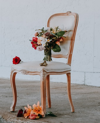 Clean upholstered chair with fresh flowers