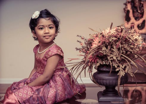 Young Indian child posing at Indian wedding event